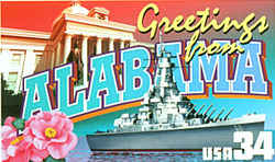 Alabama Greeting: In the background is the state capitol in Montgomery; in the foreground, the battleship USS Alabama in port at Mobile. The camellia, the state flower, is at the lower left. The state travel authority advised against using the color combinations blue and gold or red and white in the letters of the state's name, as they are the colors of arch-rival Auburn and University of Alabama sports teams, respectively. Busch rendered the letters in neutral shades of green, blue and white.