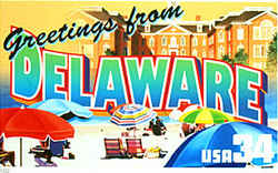 "Delaware Greeting:  A rear view of Legislative Hall, the state capitol in Dover, is seen in the background. In front is a beach scene at Fenwick Island State Park, with colorful beach umbrellas sheltering their owners from the sun. Experts consulted by PhotoAssist suggested ""altering the colors/designs of the umbrellas and beach chairs to avoid identification of specific brands."" Busch complied."