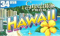 Hawaii Greeting: panoramic view of Waikiki Beach with its hotels lined up behind the strip of sand and the extinct volcano Diamond Head in the distance, and a blossom of yellow hibiscus, the Hawaii state flower, in the foreground