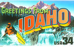 Idaho Greeting: A thrill-seeker in a yellow kayak plunges through white water on the left. A view of Shoshone Falls on the Snake River is at the right, while the Sawtooth Range of mountains is seen against the sky at the rear.
