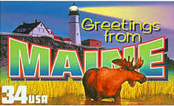 Maine Greeting: A moose, a common animal in Maine, stands in the foreground. At the rear, a lighthouse in Portland sends a beam across the night sky.