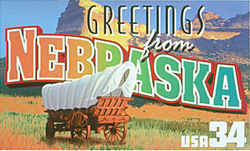 Nebraska Greeting: The design recalls the days in the mid-19th century when the state was crossed by thousands of migrants heading west on the Oregon Trail and Mormon Trail to make new lives beyond the Rocky Mountains. Scotts Bluff, the 800-foot-high promontory on the Platte River that was a landmark to the travelers, is seen rising above a covered wagon typical of those they used.