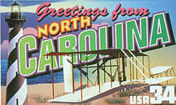 North Carolina Greeting: The design features the biplane built by Orville and Wilbur Wright that made the first manned flight by a heavier-than-air machine December 17, 1903, at Kill Devil Hill on North Carolina's Outer Banks. Dune grass native to the Outer Banks is shown beneath the plane's wings. At the left is the distinctive candy-striped lighthouse of Cape Hatteras.