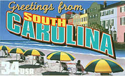South Carolina Greeting: Beachgoers sit beneath a row of identical blue-and-yellow umbrellas on the sands of Myrtle Beach. At the rear is Rainbow Row, a row of multicolored buildings in Charleston.