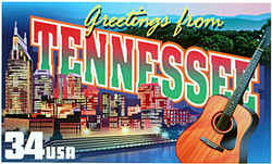 Tennessee Greeting: Tennessee's distinction as the home of country music is represented by an acoustic guitar in the foreground. Behind it is the night skyline of Nashville, the capital, and the Cumberland River that loops through the city, and in the distance are the Great Smoky Mountains.
